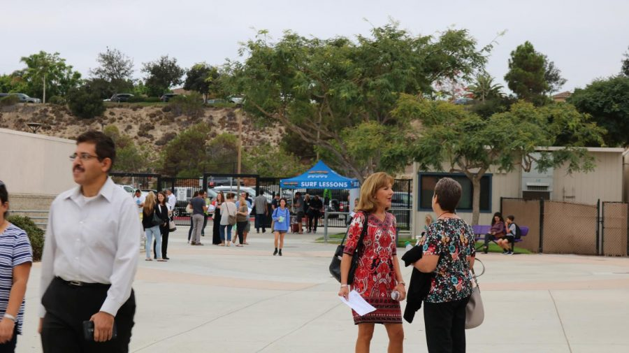 Teachers, parents and students come back to the campus to meet each other and kick off a new school year.
