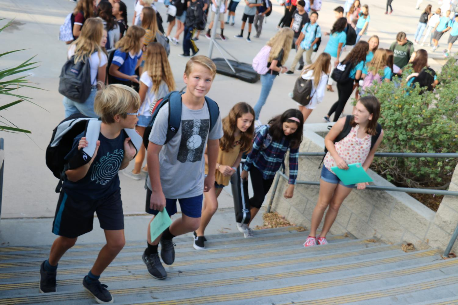 Students head to class as the first bell of the school year begins to ring.