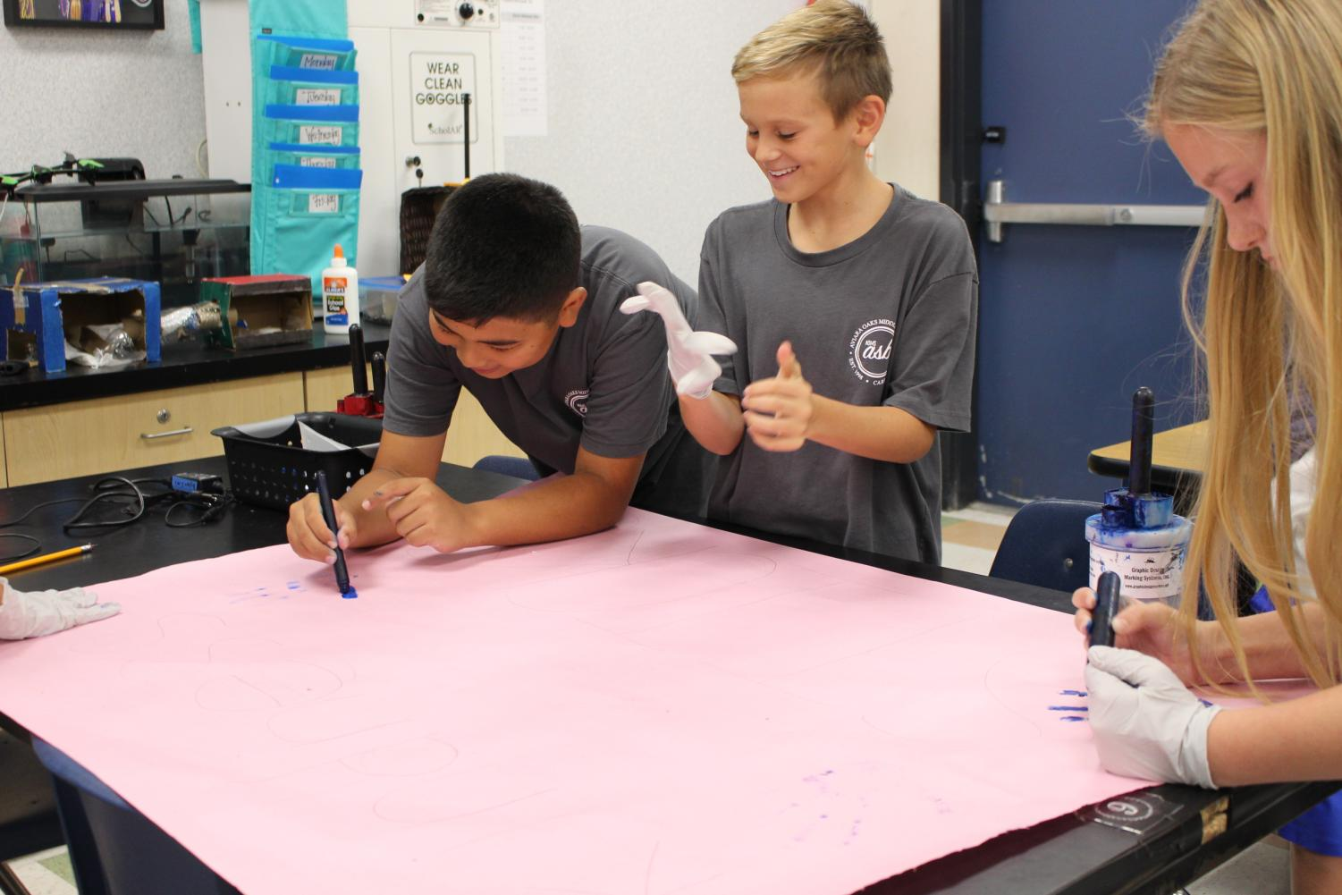 ASB students making posters for