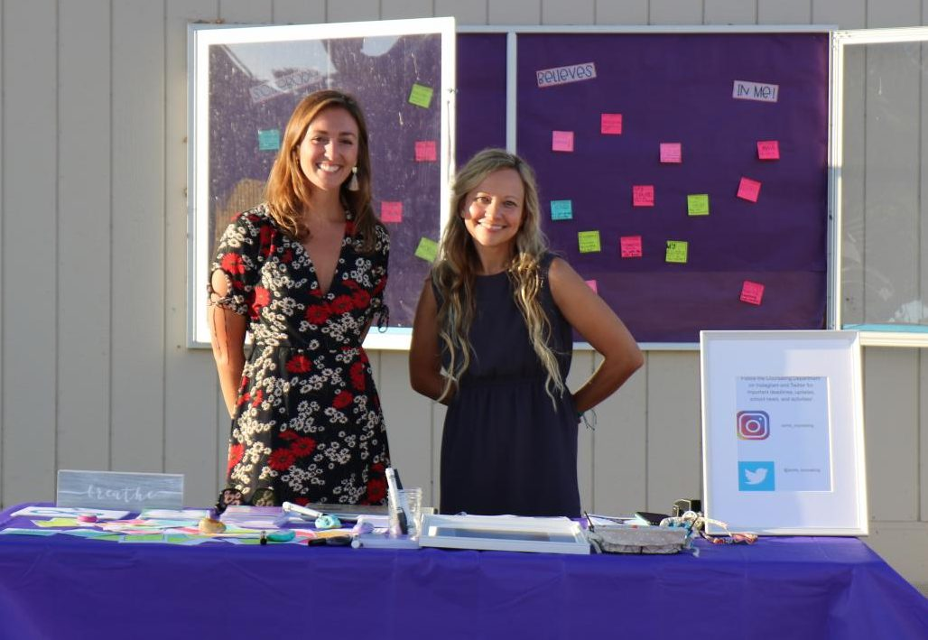 The counseling team greeting students and parents at Back to School Night