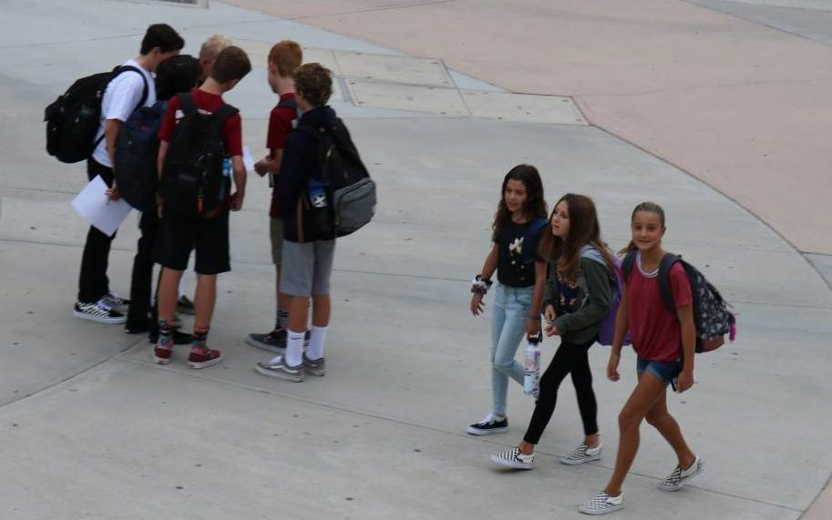 Students walking on to campus for the first day of school.